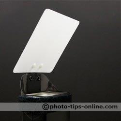 Demb Flip-it! flash reflector: mounted of a wide flash head side, front