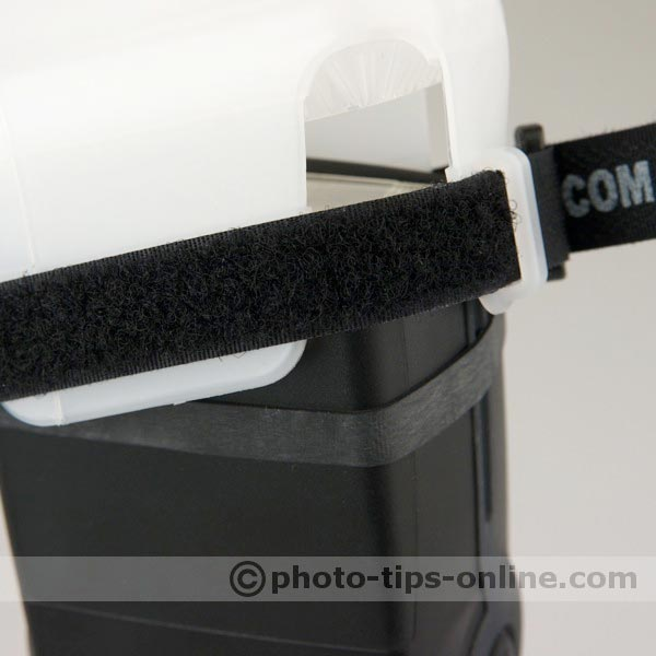 Gary Fong WhaleTail flash diffuser: rubber band and Velcro strap, attaching to a flash head