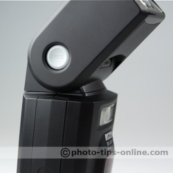 Metz Mecablitz 58 AF-1 flash: head release button depressed