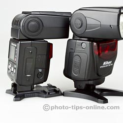 Nikon Speedlight SB-700 vs. Nikon Speedlight SB-600: side view, battery compartment doors, remote control sensors