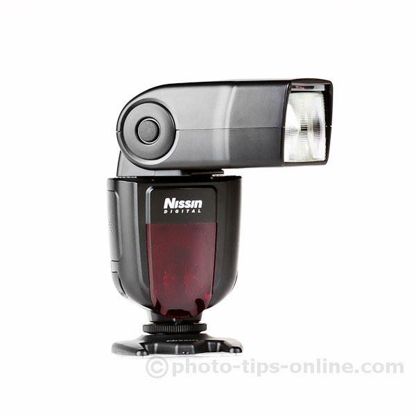 Nissin Di700 flash: release button to rotate the flash head